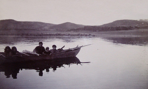 A historic photo depicting Yamana people in a row boat—an example of a group with nautical technology.